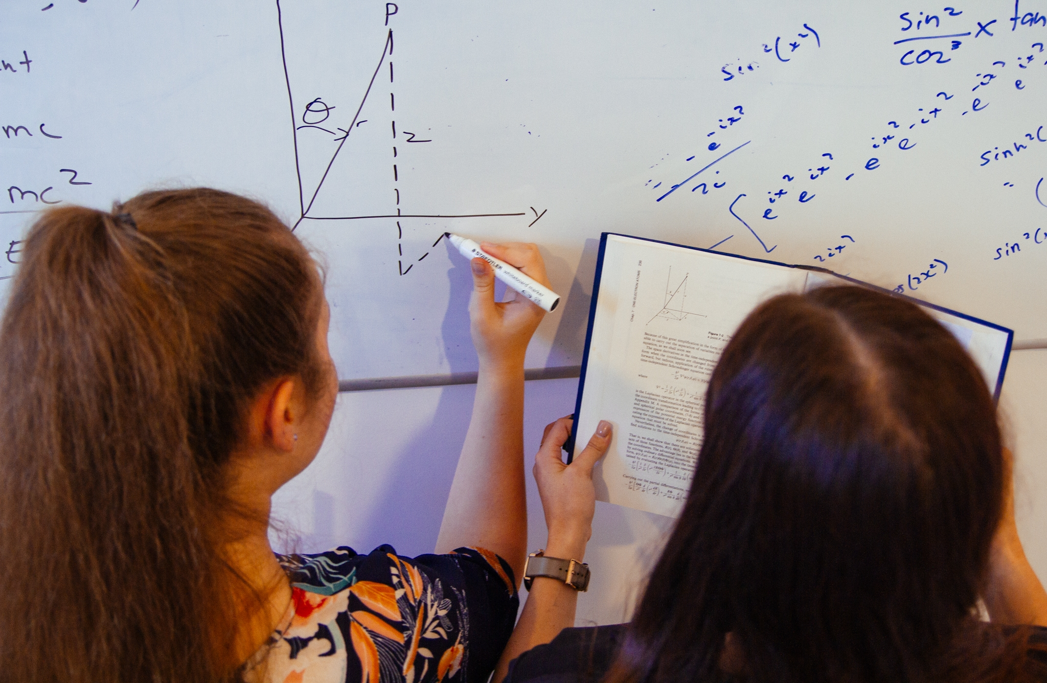 Student getting help from an A Team Tuition Tutor for Physics