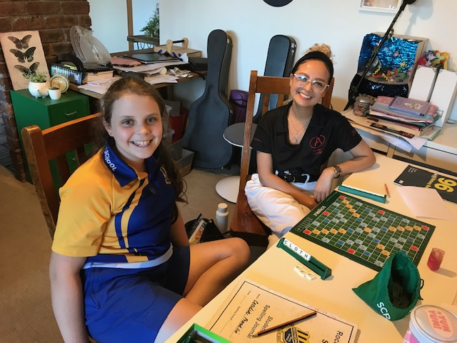 Brisbane grade five student CC with her tutor Michaela playing Scrabble